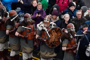 Members of the Jarl Squad march through the streets