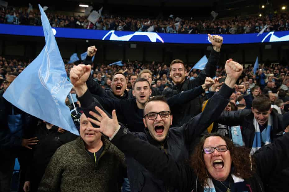 Manchester City football fans celebrate before a winning goal is ruled out by VAR decision during the UEFA Champions League Quarter Final second leg match against Tottenham Hotspur at at Etihad Stadium on April 17, 2019