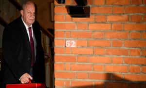 Damian Green by a wall
