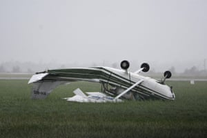 A plane flipped over by Cyclone Debbie at Bowen airport