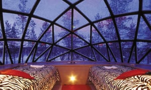 Kakslauttanen igloos in Finland where visitors can view the northern lights in bed.