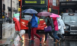 Summer weather Aug 26th 2015<br>Members of the public get caught in heavy rain in central London. PRESS ASSOCIATION Photo. Picture date: Wednesday August 26, 2015. Photo credit should read: Anthony Devlin/PA Wire