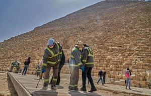 Labourers disinfect the Giza Pyramids complex on 25 March. The major attraction is currently closed