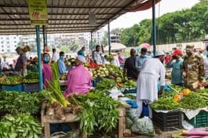Shoppers at an open-air market