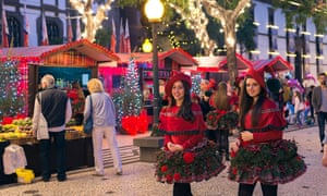 Young women in festive dress at a funchal christmas market