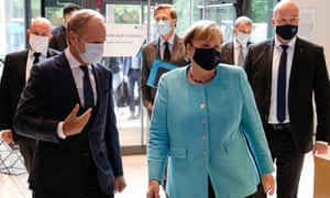 Angela Merkel with Donald Tusk (left) before a panel discussion on 30 years of German reunification last month.