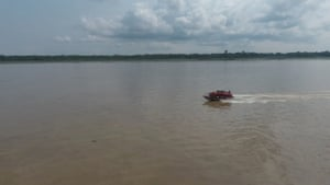 The boat used by teams detecting and treating HIV and AIDS, seen on the river.