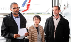 Freed French hostages Patrick Picque (R) and Laurent Lassimouillas (L) stand next to a freed South Korean hostage at Villacoublay airport.