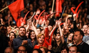 Supporters of Vetëvendosje wave Albanian national flags during the party's closing election campaign rally in Pristina.