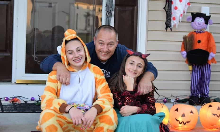 Alfred Salvatore with his daughters. 'My husband was a healthy 47-year-old man with no prior health conditions and it took his life,' said his wife, Natalie.