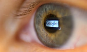 The Google logo reflected in the pupil of a human eye