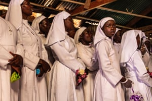 A young Legio Maria girl loses concentration during an unusually long wedding ceremony at her church in Kibera. 24th November, 2018.