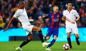 Barcelona's Andres Iniesta surges past Sevilla's Steven N'Zonzi.