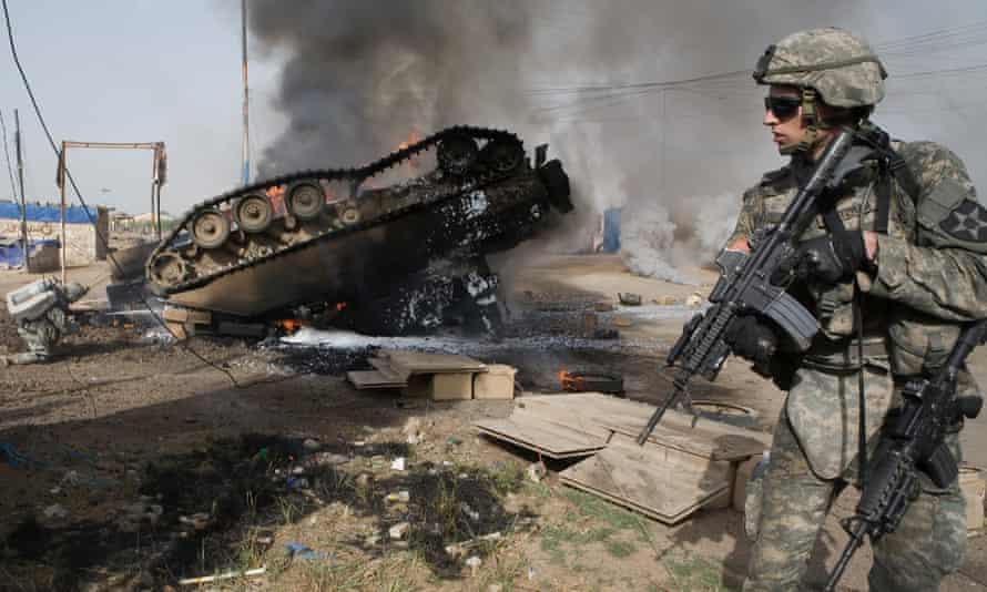 An overturned Bradley fighting vehicle in Baghdad, in May 2007. The vehicle was hit by an IED, killing six American soldiers and a translator.