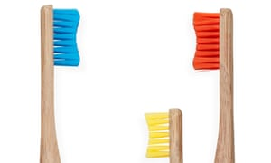 Blue, red and smaller yellow toothbrush