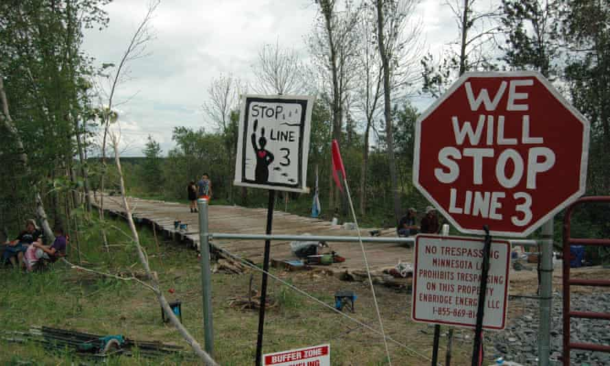 Protest signs at Fire Light Camp, where Dawn Goodwin leads a four-day prayer ceremony.