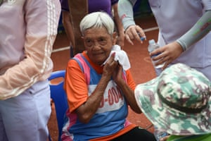 An elderly woman in the 80-85 age category resting after completing the 400m sprint