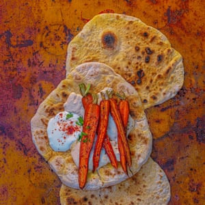 Barbecued new-season carrots with cumin, chilli, orange zest and rosemary, and flatbreads with white bean hummus.