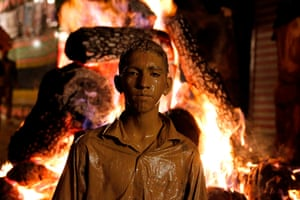Young person next to bonfire