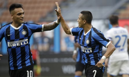 Alexis Sánchez, right, celebrates with Lautaro Martínez after scoring his Inter's second goal against Brescia.