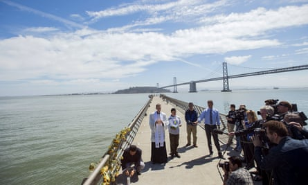Father Cameron Faller leads a prayer vigil for shooting victim Kathryn Steinle on Pier 14 in San Francisco.