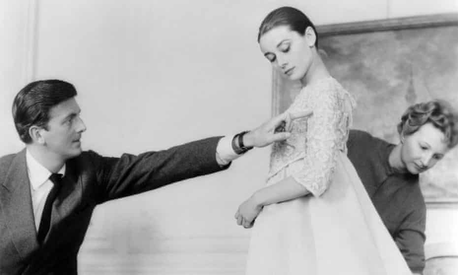 Hubert de Givenchy with Audrey Hepburn in his Paris workshop; the Hollywood star said of his clothes: 'I put them on and I feel protected.'