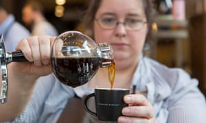 A barista in Starbucks. A not-for-profit group sued coffee roasters, distributors and retailers in a case that has been developing for eight years.