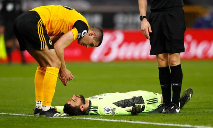 Conor Coady looks at Rui Patrício after accidentally injuring his Wolves teammate against Liverpool.