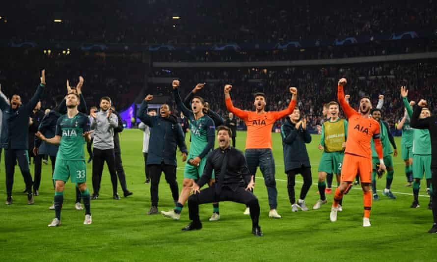 Tottenham players and staff celebrate in Amsterdam