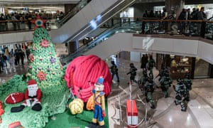 Hong Kong riot police secure an area in shopping mall on Christmas Eve.
