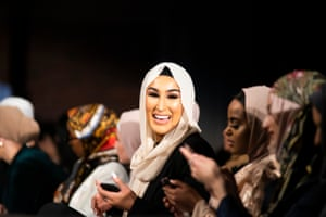 Influencer and makeup artist Hawra Khalil sits in the front row of the Mod Markit show