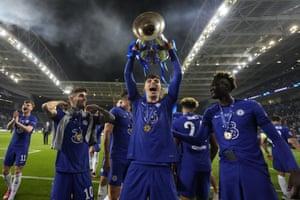 Chelsea's match winner, Kai Havertz, hoists the silverware.