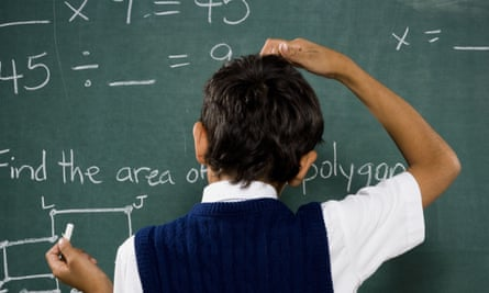 Boy at a chalkboard doing equations