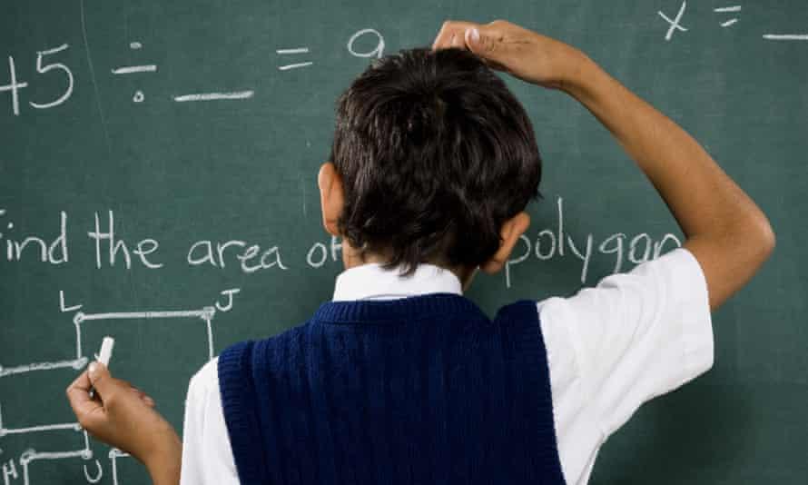 A schoolboy at the blackboard