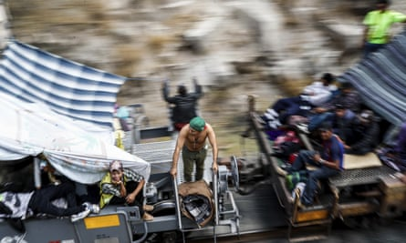 Central American migrants ride a northern-bound train known as 'La Bestia,' or the Beast, as they arrive in Hermosillo, Sonora state.