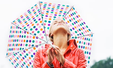 A woman with a dotted umbrella