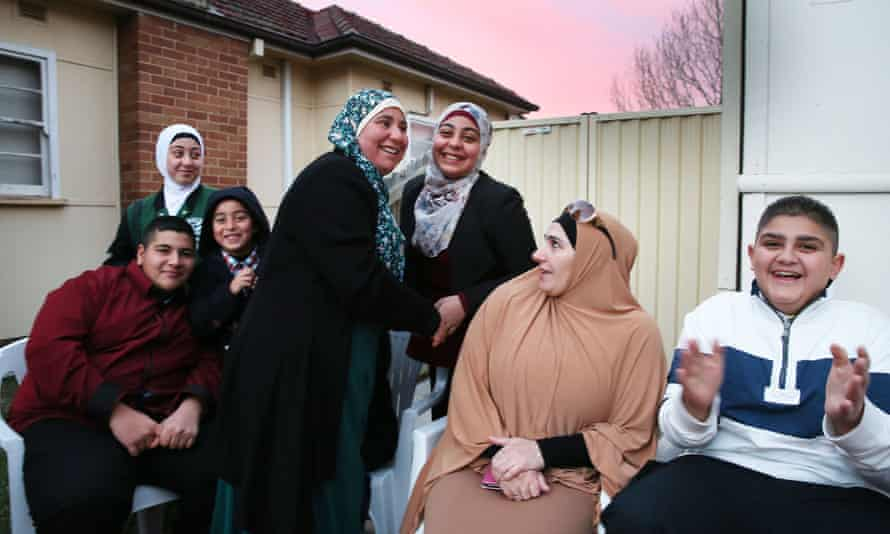 Families and friends gather at a house near the Lakemba mosque in Sydney