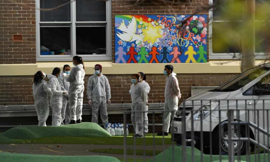 Workers conduct a deep Covid clean at Carlton public school in Sydney on 23 August. A report published by the National Centre for Immunisation Research and Surveillance has found only 2% of children who contract coronavirus require hospitalisation.