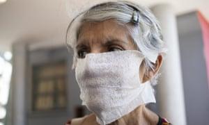 A woman wears a homemade mask at the Clinic University Hospital in Caracas, Venezuela.