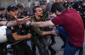 A plainclothes police officer kicks an LGBT rights activist in Istanbul
