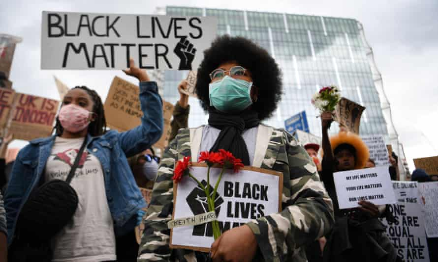 People take part in a Black Lives Matter protest outside the US Embassy in London on 7 June.