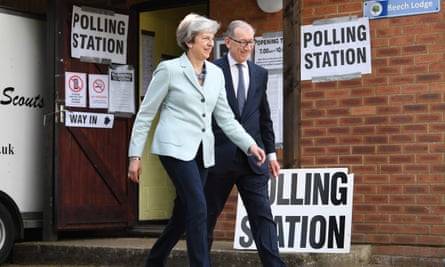 ritain's Prime Minster Theresa May (L) and her husband Phillip (R) cast their vote at a polling station during the European elections in her Maidenhead constituency in Britain, 23 May