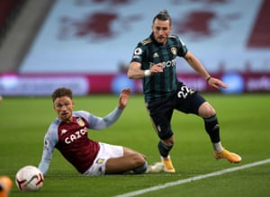 Villa's Matty Cash in action with Leeds United's Jack Harrison