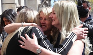 Janet Skinner (centre), with her niece Hayley Adams (right) and her daughter Toni Sisson, celebrate outside a London court