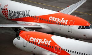 """EasyJet aircrafts are seen on the tarmac at Terminal 1, marking the official opening of the new Berlin-Brandenburg Airport (BER) """"Willy Brandt"""", in Schoenefeld near Berlin, Germany October 31, 2020."""