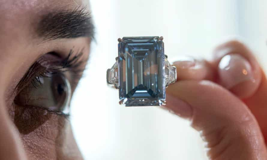 A Christie's employee eyes the Oppenheimer Blue diamond of 14.62 carats.