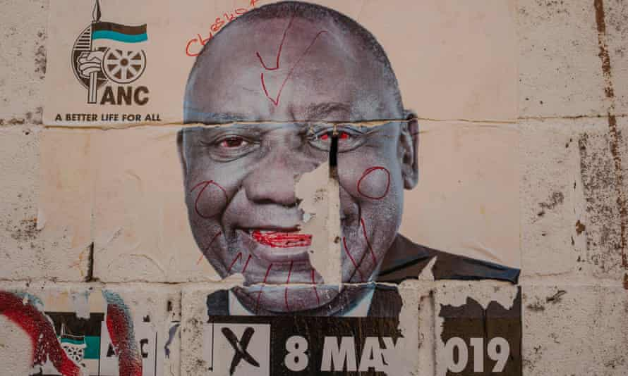 A defaced election poster of President Cyril Ramaphosa in Johannesburg.