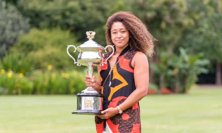 Naomi Osaka shows off the Australian Open trophy following her victory in Melbourne.