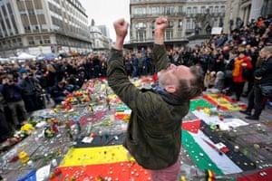 A man reacts at a street memorial
