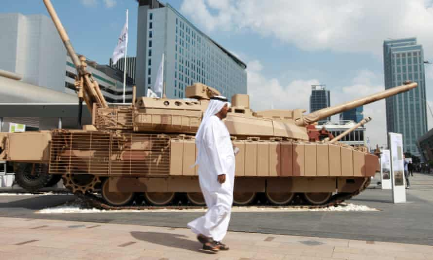 A visitor walks past a battle tank at the International Defence Exhibition in Abu Dhabi